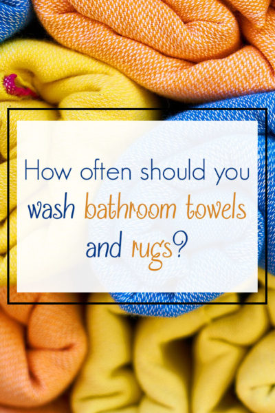 How often should you wash bathroom towels and rugs?